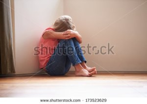 stock-photo-unhappy-child-sitting-on-floor-in-corner-at-home-173523629