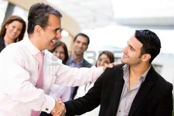 13899699-business-men-closing-deal-with-a-handshake